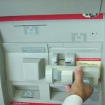 An ATM skimmer that fits over the card insert slot