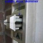 Some ATMs are in building lobbies that require visitors to swipe their ATM card at the door. This device was found attached to the reader at a lobby entry. This ATM door skimmer was originally flush with the device. The skimmer and the real reader have been pulled away from the face to better show the two devices.