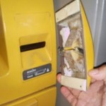A closeup of the ATM card skimmer removed from the face of the ATM