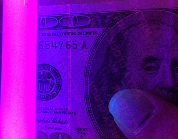 MrMouse showcases the ultraviolet security strip in his fake $100 bills. The WillyClock bit is just an image watermark.