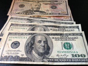 "Counterfeit $100s and $50s from ""Willy Clock,"" allegedly the online alias of a Texas man living in Uganda."