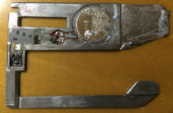 The backside of the insert skimmer reveals a tiny battery and a small data storage device (far left).