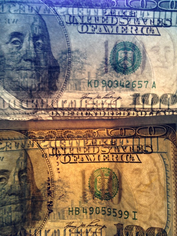 The fake $100 (above) has a much less defined Ben Franklin as a watermark.