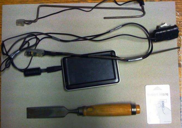 "Equipment used by crooks to conduct ""eavesdropping"" or ""wiretapping"" attacks on ATMs."