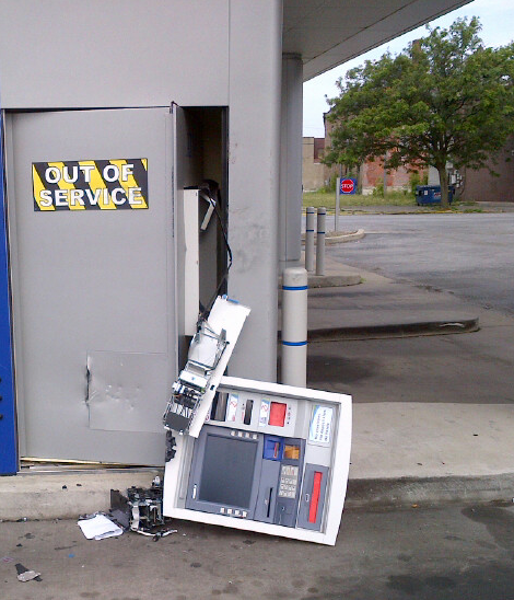 Thieves with crowbars did massive and costly damage to this ATM, but were thwarted in cracking the safe.