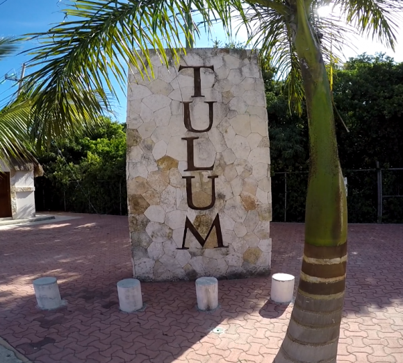 A sign across the street from the police department in Tulum.