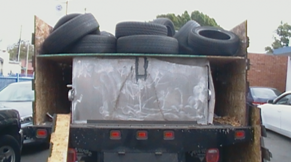 A bladder made to look like it's hauling used tires.