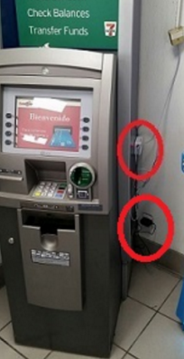 Two network cable card skimming devices, as found attached to this ATM.