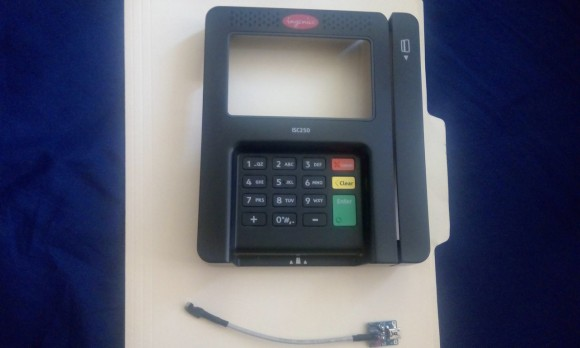 A skimmer made to be fitted to an Ingenico credit card terminal of the kind used at Walmart stores across the country. Image: Hold Security.
