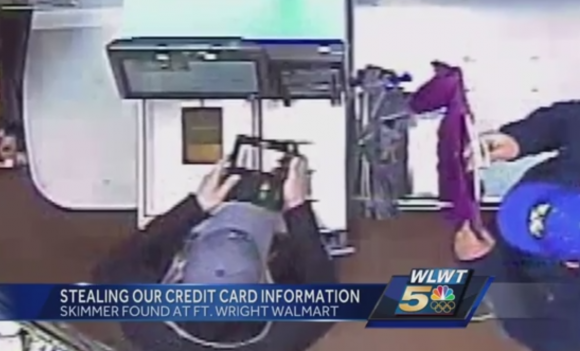 Footage of crooks installing the card skimmers at a Walmart self-checkout terminal. Source: WLWT.