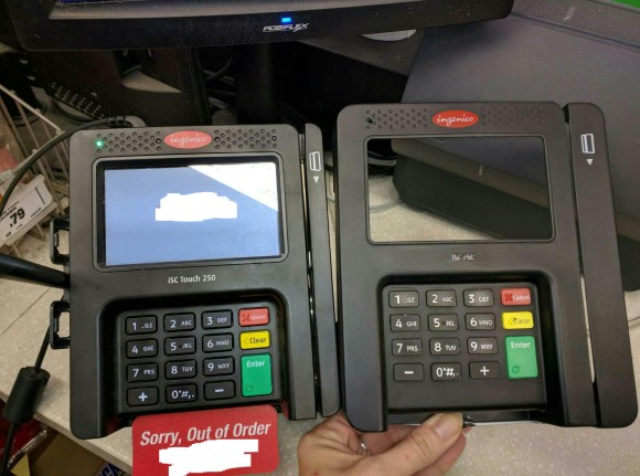 "An ""overlay"" skimming device (right) that was found attached to a card reader at a retail establishment."
