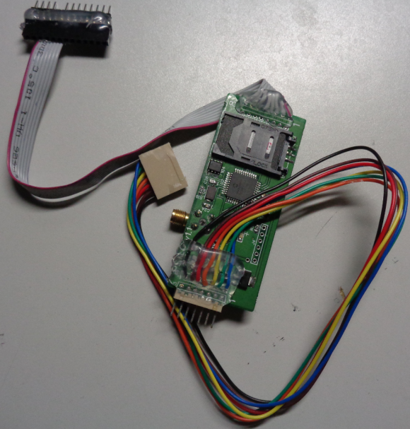 The reverse side of this GSM-based pump skimmer shows a SIM card from T-Mobile.