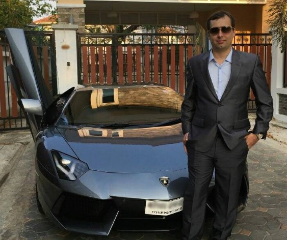 Alexandre Cazes, standing in front of one of four Lamborghini sports cars he owned. Image: Hanke.io.